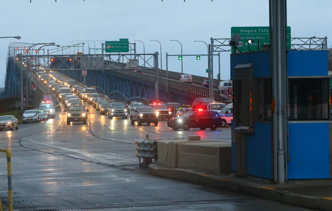 Traffic begins to pass after a multi-vehicle accident is cleared by State Police, Border Patrol and rescue crews at the toll plaza on the Grand Island bridge in Grand Island, N.Y., on  Wednesday,  Jan. 4, 2017. (John Hickey/Buffalo News)