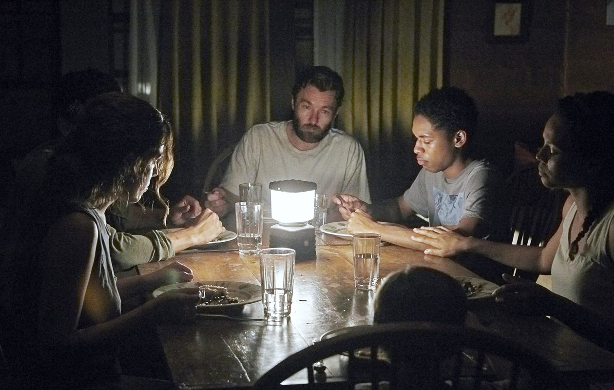 Riley Keough, left, Christopher Abbott, Joel Edgerton, Kelvin Harrison Jr., Carmen Ejogo and Griffin Robert Faulkner in 'It Comes at Night.' (Eric McNatt, A24)