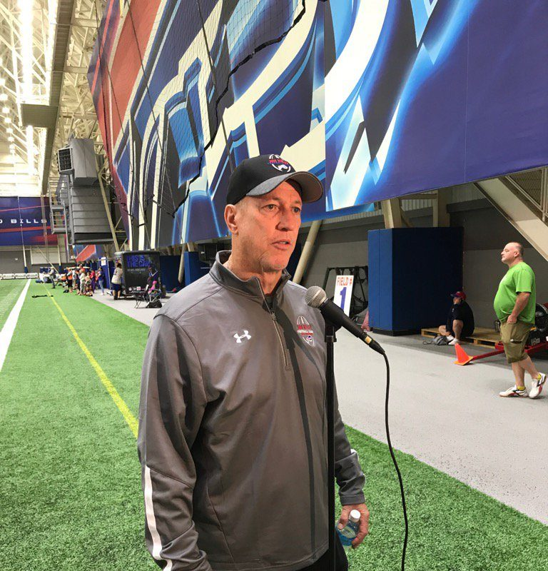 Jim Kelly speaks with reporters at his football camp in the ADPRO Sports Training Center. (Vic Carucci/Buffalo News)