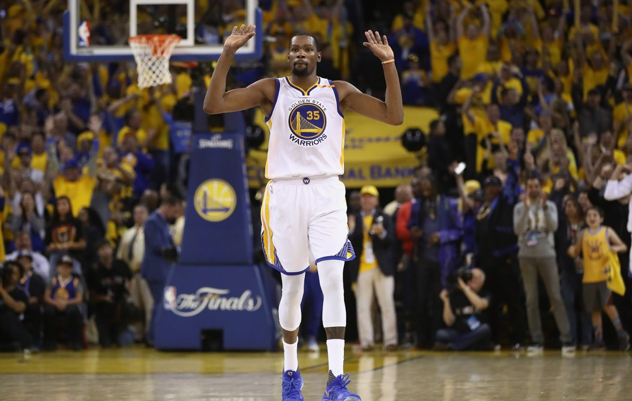 Kevin Durant of the Golden State Warriors celebrates in the final moments of their 129-120 win in Game 5 over the Cleveland Cavaliers to win the 2017 NBA Finals (Ezra Shaw/Getty Images)