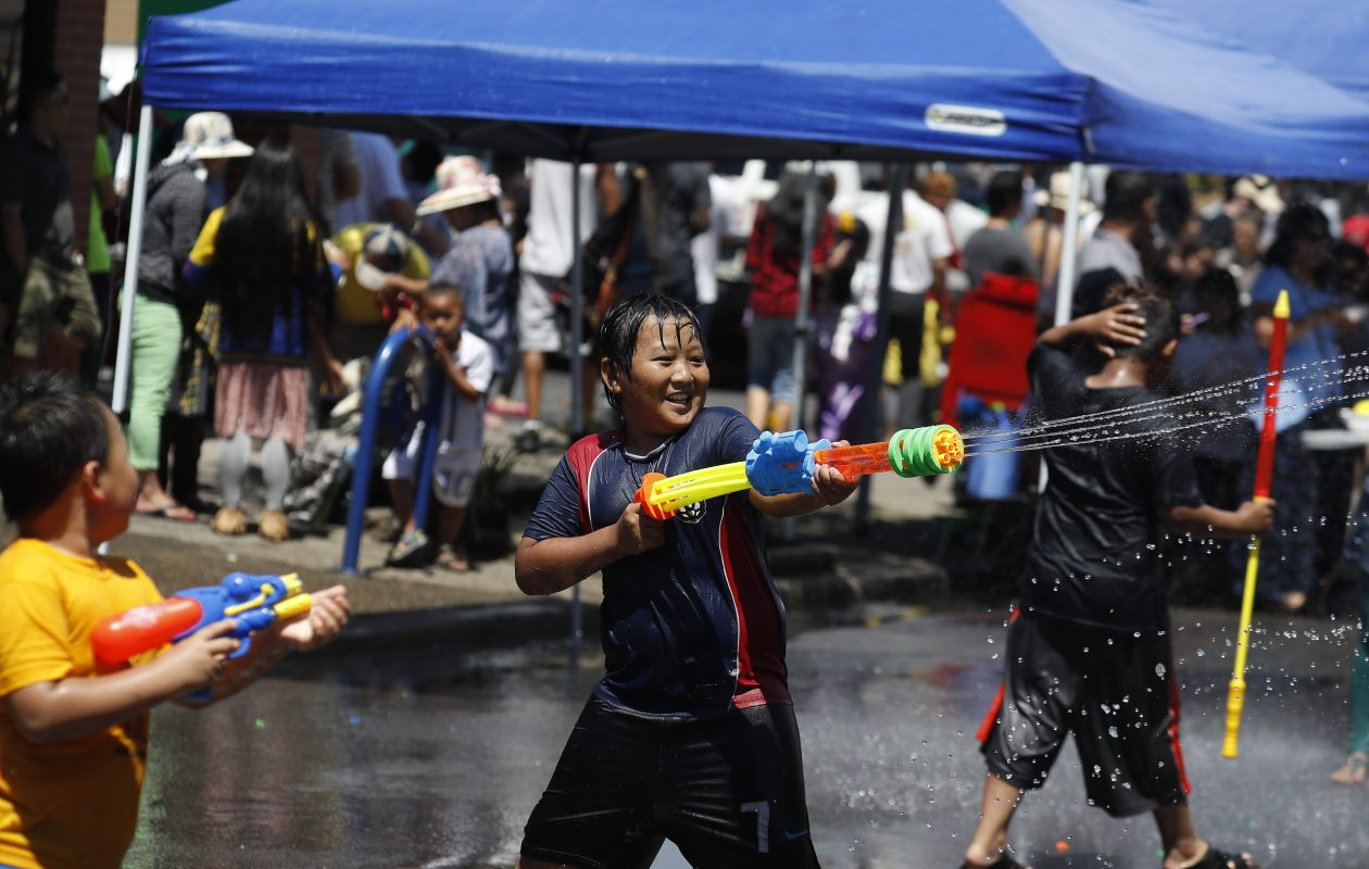 Bleh Reh , 10, shoots his squirt gun at other children as they each use  hoses and squirt guns at the Myanmar Water Festival, which is the largest festival in the Burmese community on Grant Street ,in  Buffalo, N.Y. on Saturday June 24, 2017.   (John Hickey/Buffalo News)