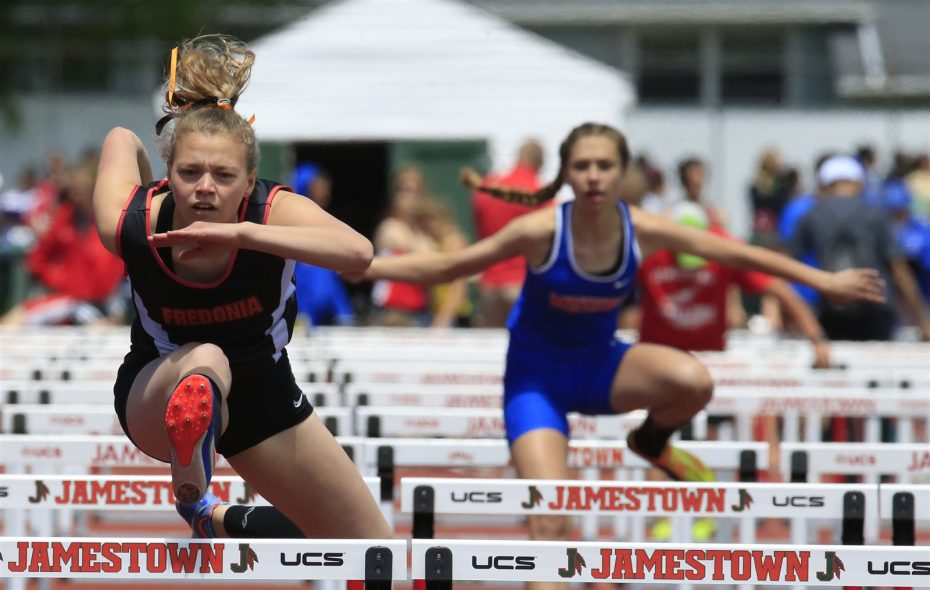 Lydia Lanski runs to victory in the Division II 100 hurdles during the Section VI track and field championship meet at Strider Field in Jamestown. (Harry Scull Jr./Buffalo News)