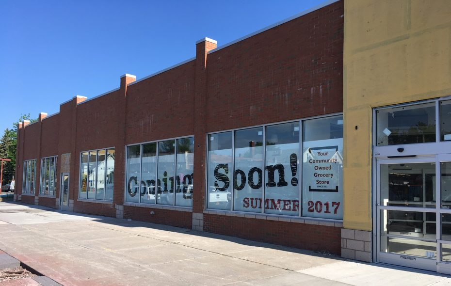 Signage announcing that a new Lexington Co-op is opening on Hertel Avenue