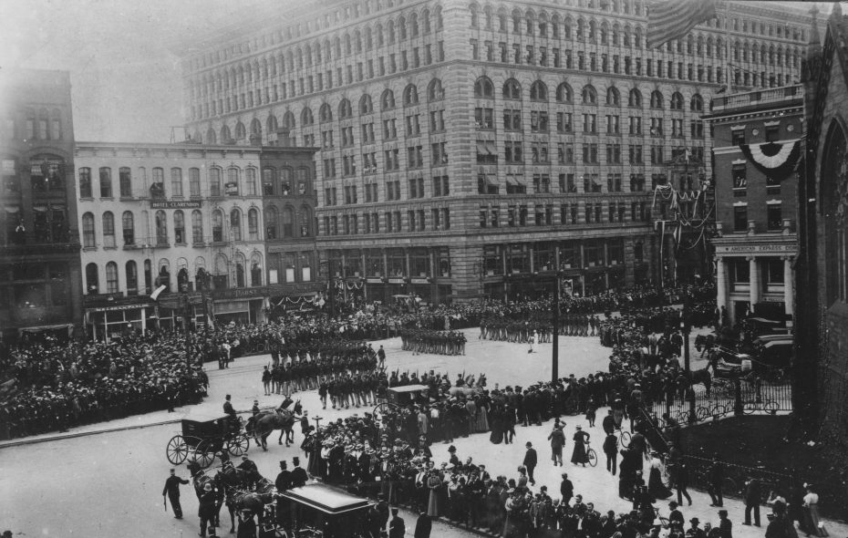 President William McKinley's funeral procession turns off Church Street and onto Main Street, passing both St. Paul's Cathedral and the Ellicott Square Building. (Photo courtesy of the Buffalo History Museum)