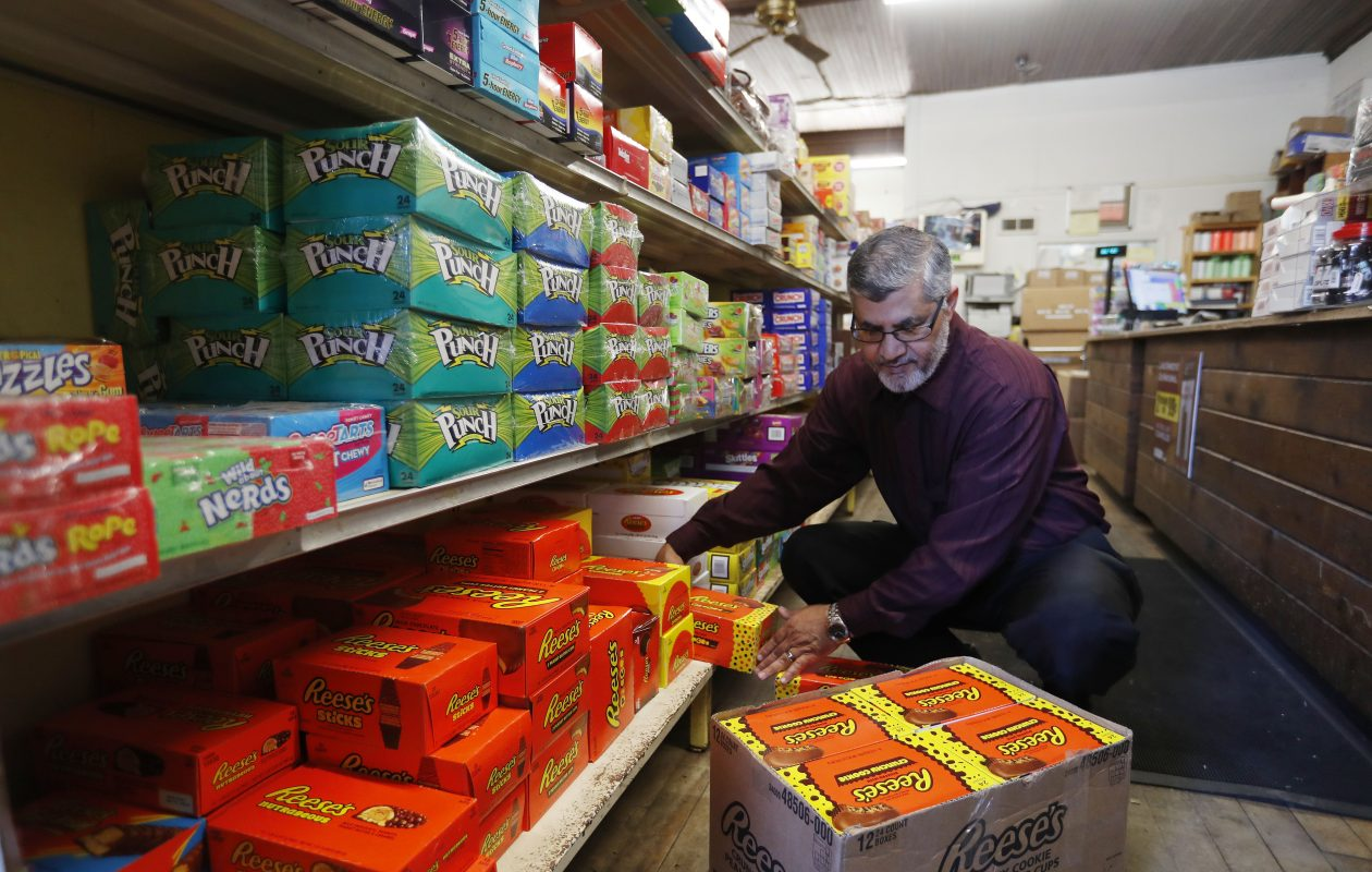 Mohamed T. Albanna stocks the shelves at AB&S Wholesale on Clinton Street in Buffalo on Thursday, June 1, 2017.           (Mark Mulville/Buffalo News)