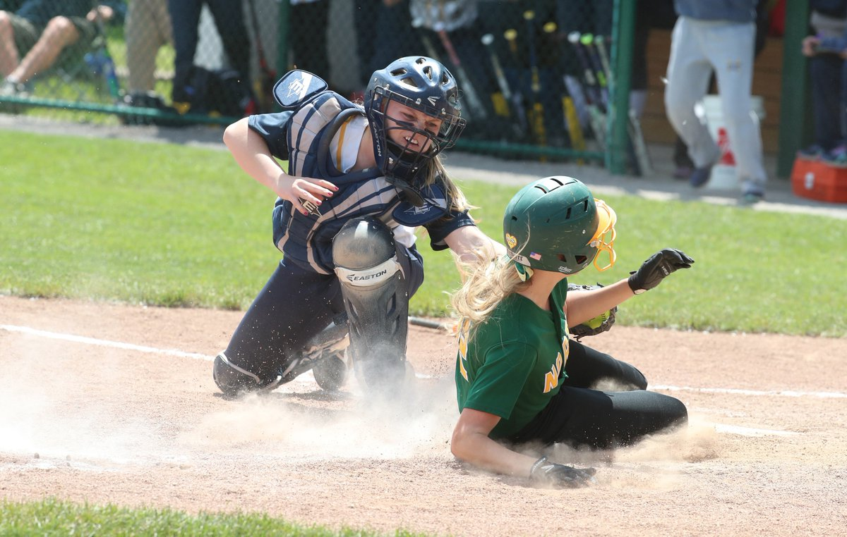 Williamsville North's Rachel Dimitroff is tagged out at home by Victor catcher Kyra Grooms during Friday's Class AA Far West Regional game at SUNY Brockport. (James P. McCoy/Buffalo News)