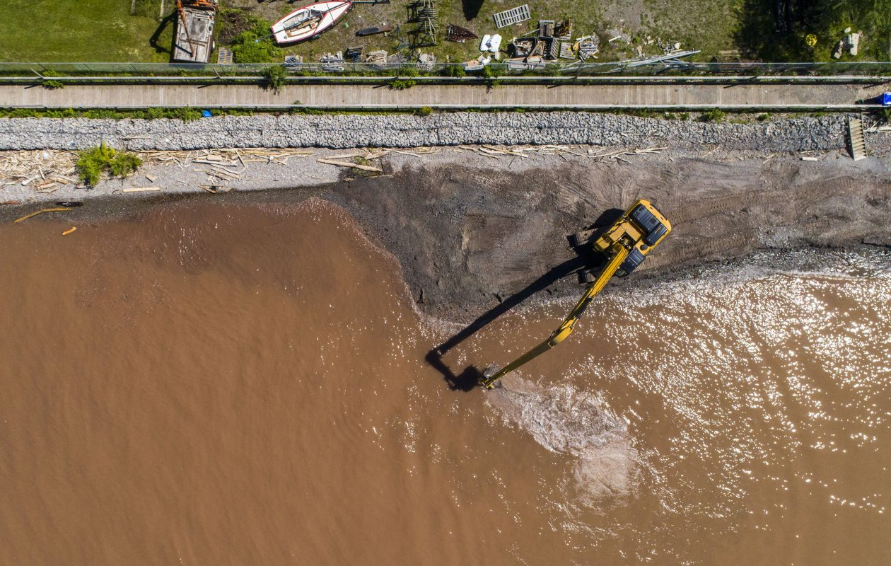 Excavators work to reinforce the beach in Olcott to repair damage from flooding on June 7, 2017. (Derek Gee/Buffalo News)