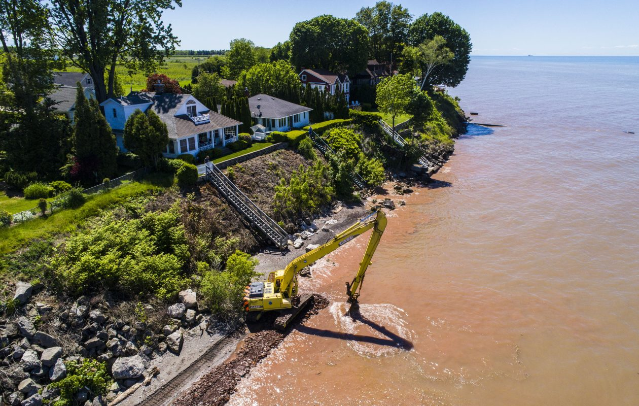 Excavators work to reinforce the beach in Olcott to repair damage from the recent flooding on Wednesday, June 7, 2017. (Derek Gee/Buffalo News)