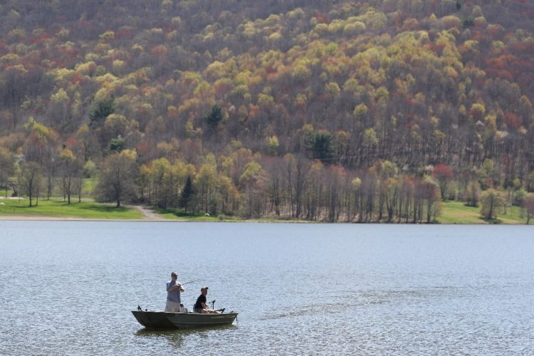 Tom Forness, left and Jim Fisher, of Salamanca fish on Quaker Lake earlier this spring. Plans call for 15 new full-service cottages to be added to the Quaker Lake area at Allegany State Park. (Sharon Cantillon/Buffalo News)