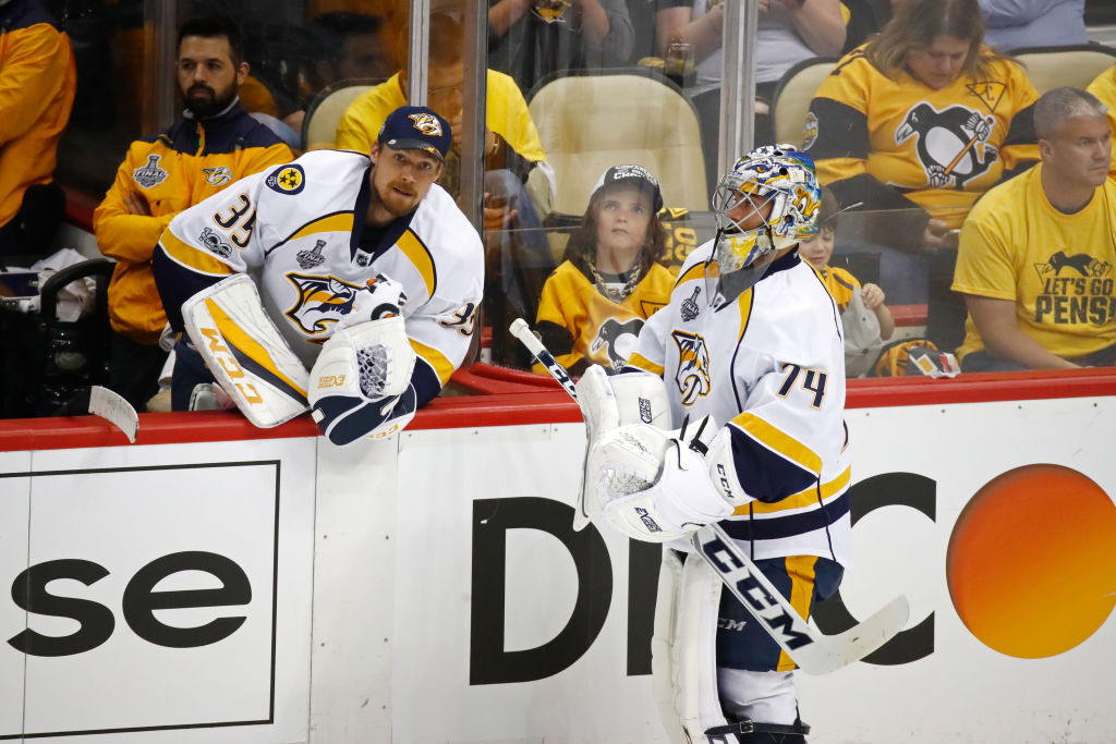 Pekka Rinne, left, talks to backup Juuse Saros after getting pulled in Game Five (Getty Images).