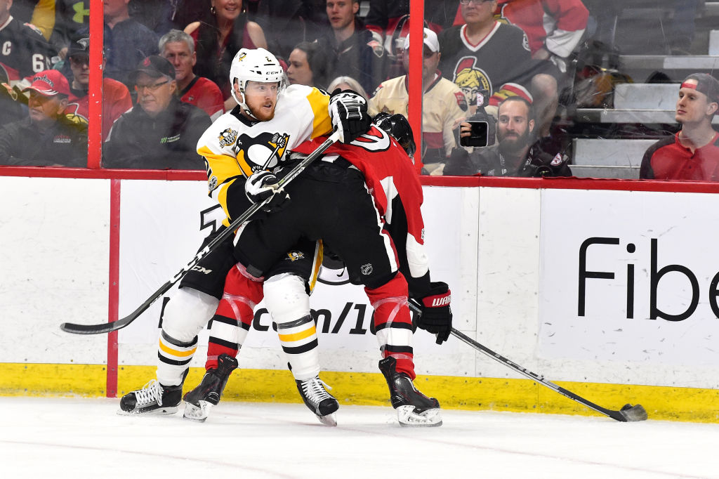Former Sabres defenseman Chad Ruhwedel works against Ottawa's Bobby Ryan while playing for the Penguins in the Eastern Conference final (Getty Images).