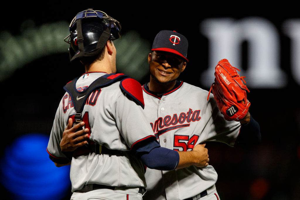 Ervin Santana of the Twins celebrates his MLB-leading third shutout of the season Friday in San Francisco with catcher Jason Castro (Getty Images).