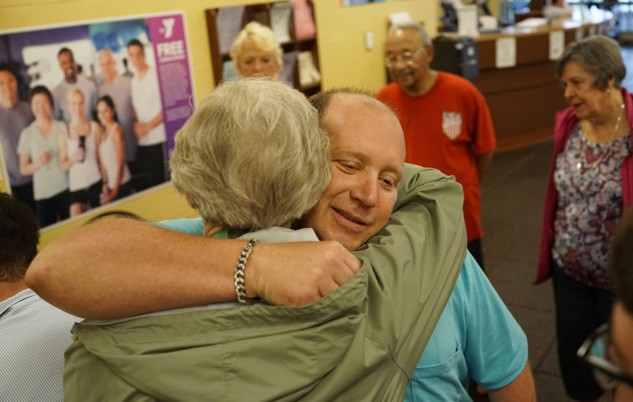Scott Zelasko, who suffered a stroke 12 years ago, gets a hug from a well-wisher at a surprise party to celebrate his 50th birthday at the Independent Health Family Branch YMCA in Amherst, Thursday, June 15, 2017.  Zelasko works out at the YMCA six days a week while trying to regain function on the left side of his body.  (Derek Gee/Buffalo News)