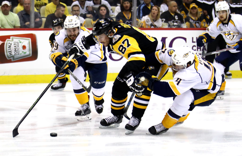 Sidney Crosby dangles past Ryan Ellis (4) and Roman Josi to set a tone in the first minute of play (Getty Images).