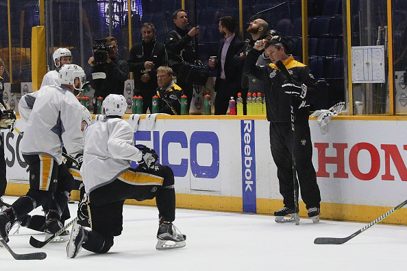 Penguins coach Mike Sullivan talks to a group of his players during practice Sunday in Nashville (Getty Images).
