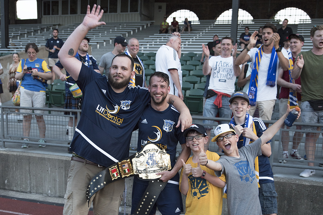 Chris Walter, holding the man of the match belt, scored the game's opening goal on a sixth minute penalty kick. (Photo credit: RJZ Photography)