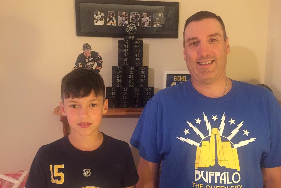 C.J. and John Gworek with The Eichel Tower at their home in Spring Hill, Tenn. (Mike Harrington/Buffalo News).