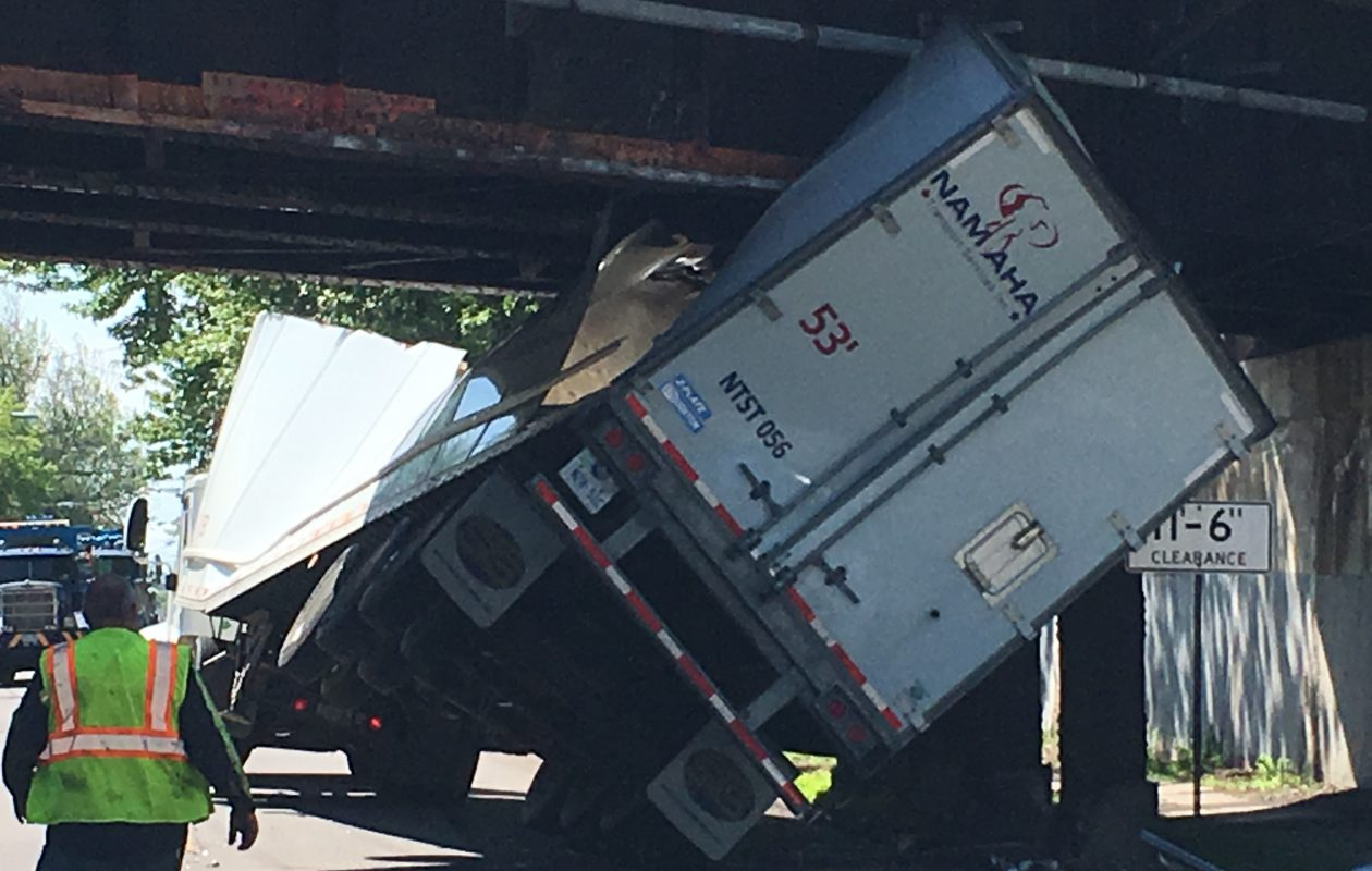 A  tractor-trailer driven by Kirisanthan Senathi, 24, of Scarborough, Ont., crumpled after hitting a low railroad bridge over Young Street in the City of Tonawanda on May 30.  (Photo courtesy City of Tonawanda police)
