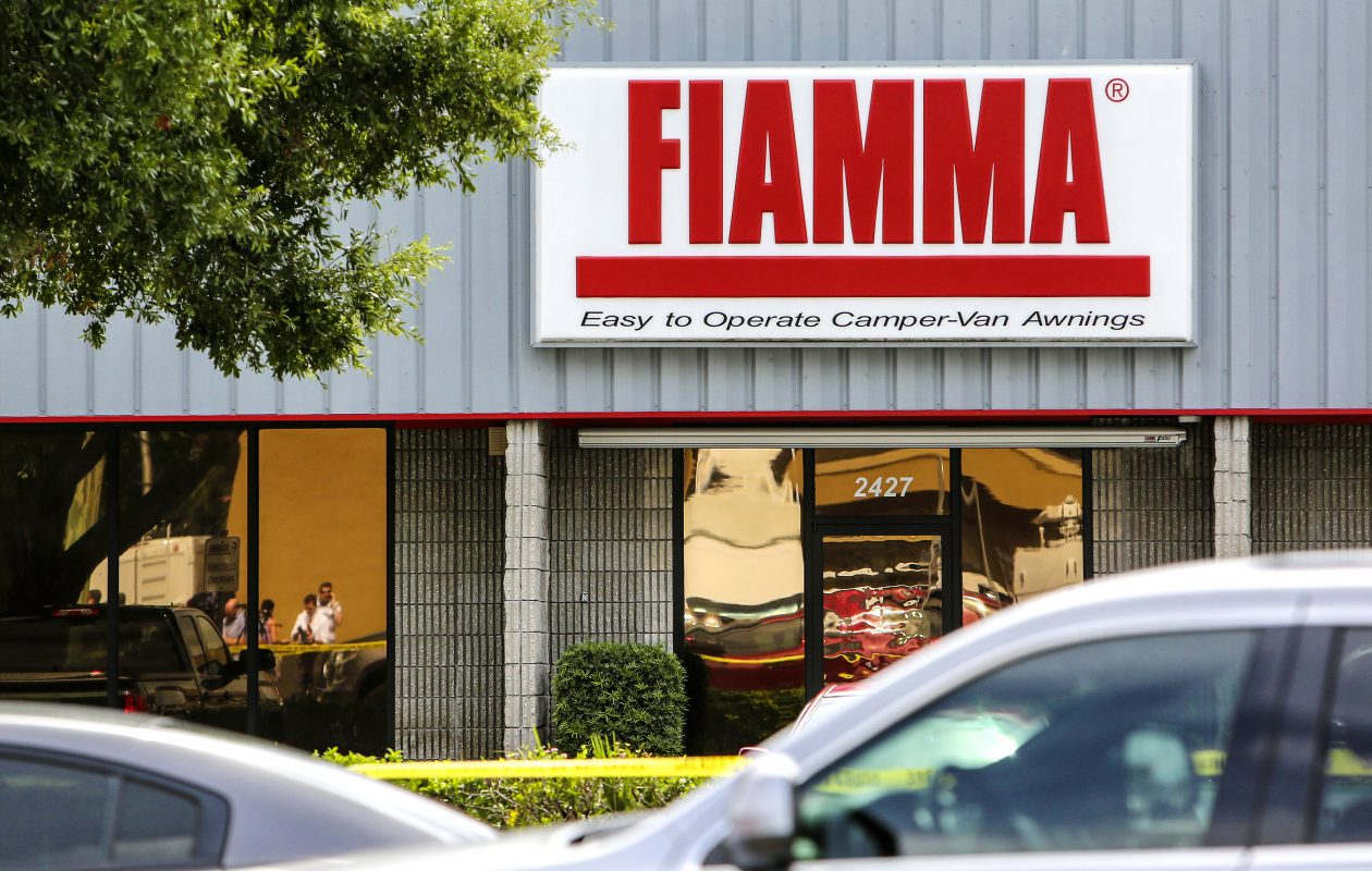 Law enforcement officials investigate the scene where five employees were killed in a shooting at Fiamma, a business on North Forsyth Road near Hanging Moss Road near Orlando, Fla., the Orange County Sheriff's Office reported this morning, June 5, 2017. (Jacob Langston/Orlando Sentinel/TNS)