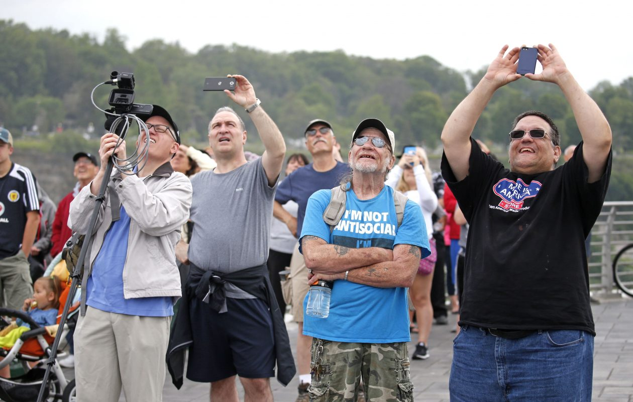 Onlookers at Terrapin Point on Goat Island view and try to photograph Erendira Wallenda's stunt over Niagara Falls on Thursday, June 15, 2017. (Robert Kirkham/Buffalo News)