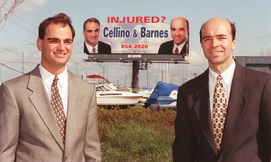Ross Cellino, left and Stephen Barnes stand in front of one of their law firm's billboards on May 22, 1997. (Sharon Cantillon/News file photo)
