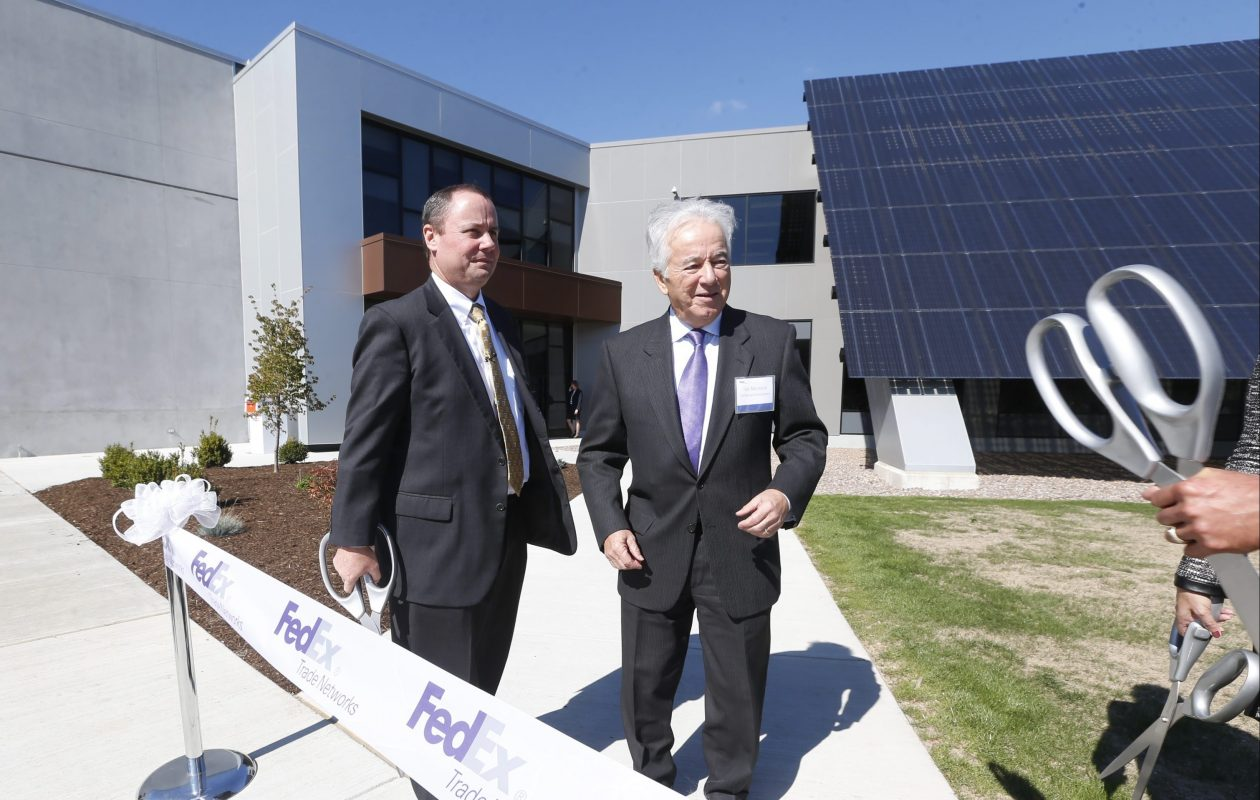 Thomas Montante, right, and FedEx CEO Jack Muhs celebrate its move into the Riverview Solar Technology Park in Tonawanda, New York's first solar-ready business complex. (Robert Kirkham/Buffalo News file photo)