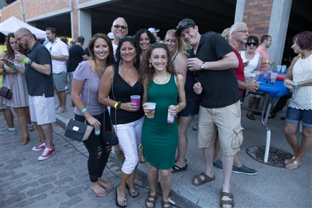 Smiles at BBQ and Blues Bash in Cobblestone District
