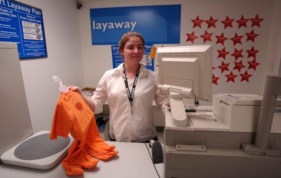 Kmart sales associate Lauren Buckley, working the layaway desk at the West Seneca Kmart. (Buffalo News/Robert Kirkham)