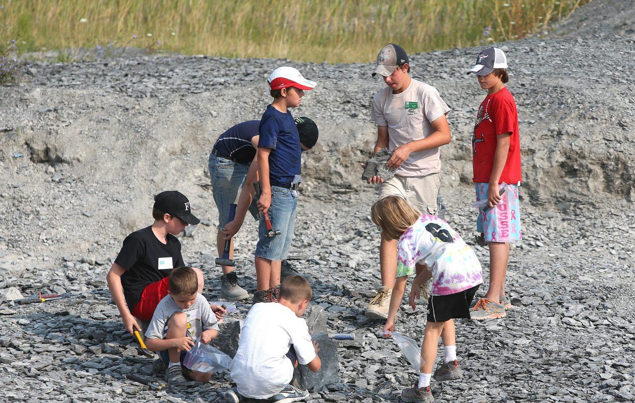 Children dig for fossils at the Penn Dixie Site in Hamburg in 2013.   (Robert Kirkham/Buffalo News)