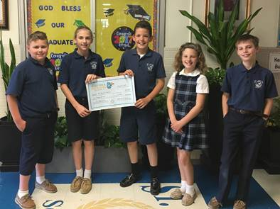 St. Amelia School students celebrate their school being named state champions of the Great American Can Roundup's School Recycling Challenge. From left are  Nolan Hickey, Rachel Coupal, Dan Mucica, Braelyn Tucciarone and Justin Johnson.