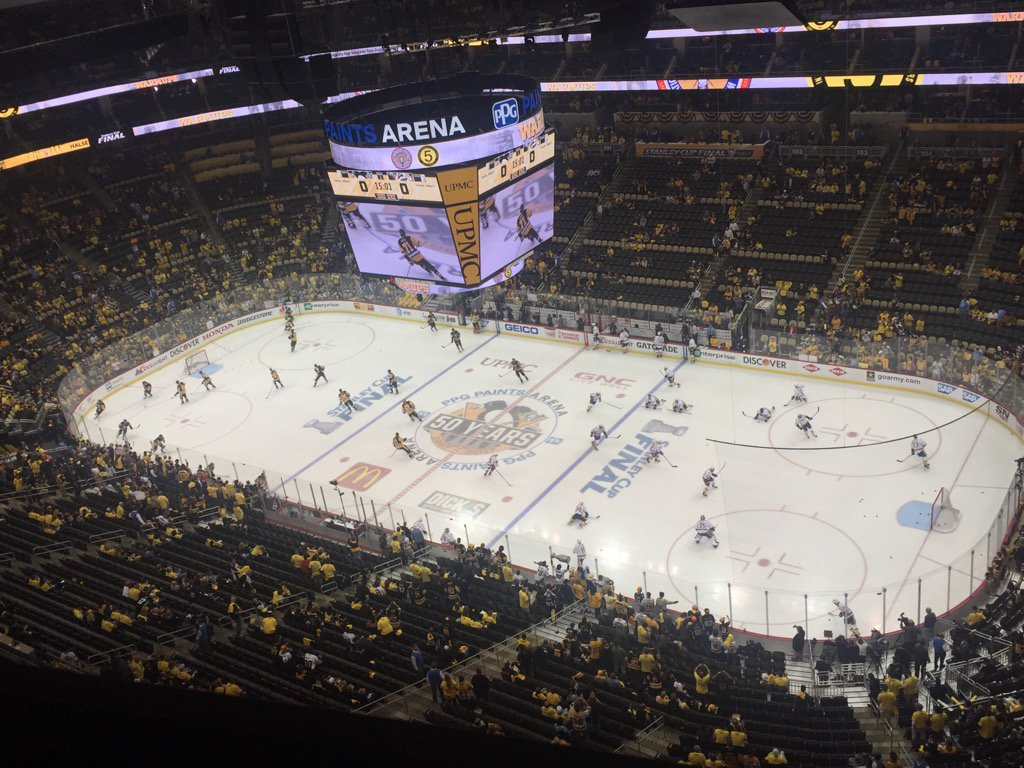 The Penguins and Predators warm up before Game Five in PPG Paints Arena (Mike Harrington/Buffalo News).