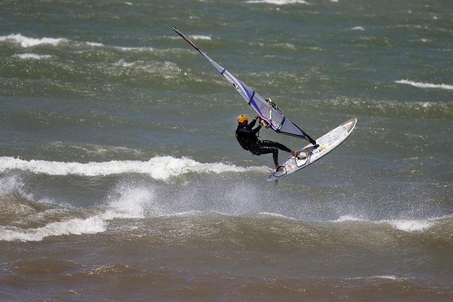 A windsurfer catches air from a wave at Hamburg Beach.            (Mark Mulville/Buffalo News)