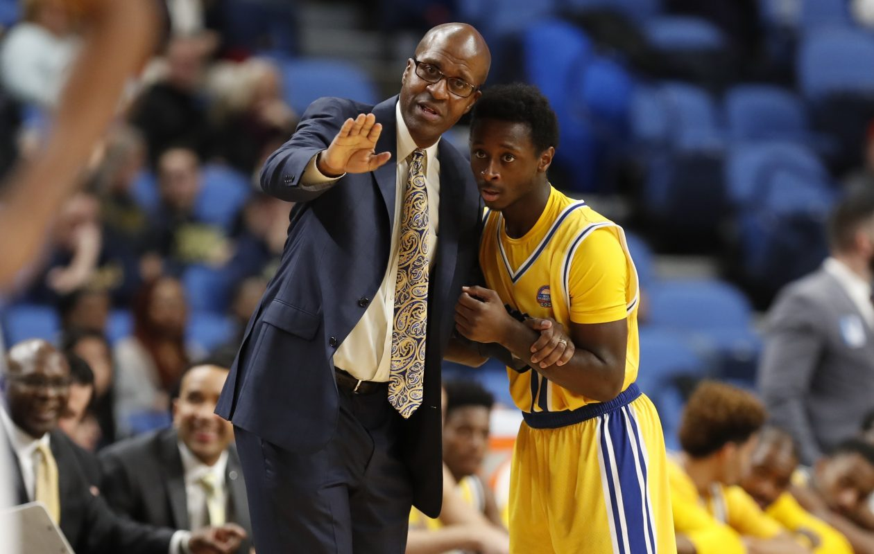 Canisius coach Reggie Witherspoon talks with guard Malik Johnson during a break against the University at Buffalo during first half action at the Big 4 classic at the Key Bank Center on Saturday, Dec. 17, 2016. (Harry Scull Jr./Buffalo News)
