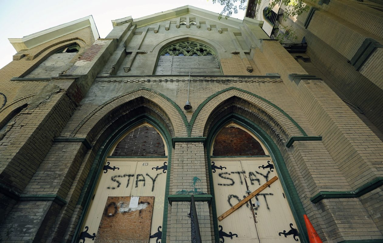 Boarded-up doors carried a warning at the church that was vacant and crumbling on Sherman Street until it was demolished in early July. (Derek Gee/News file photo)