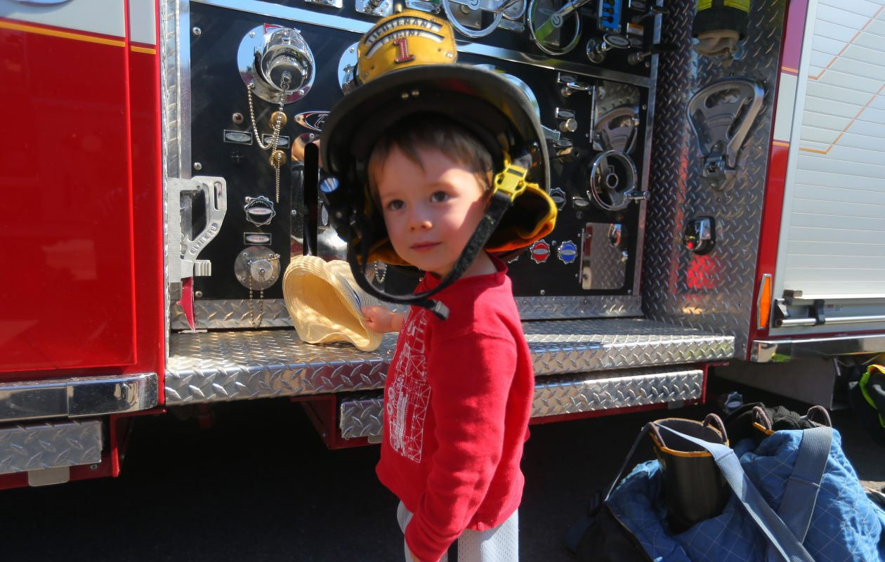 Max Dreyfus, 2, tries on a fire helmet.  (John Hickey/Buffalo News)