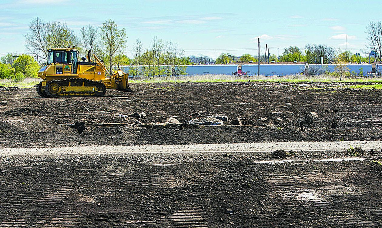 A bulldozer clears debris from a large portion of the former Bethelehem Steel site in Lackawanna that is being purchased by Erie County.  (Derek Gee/Buffalo News)