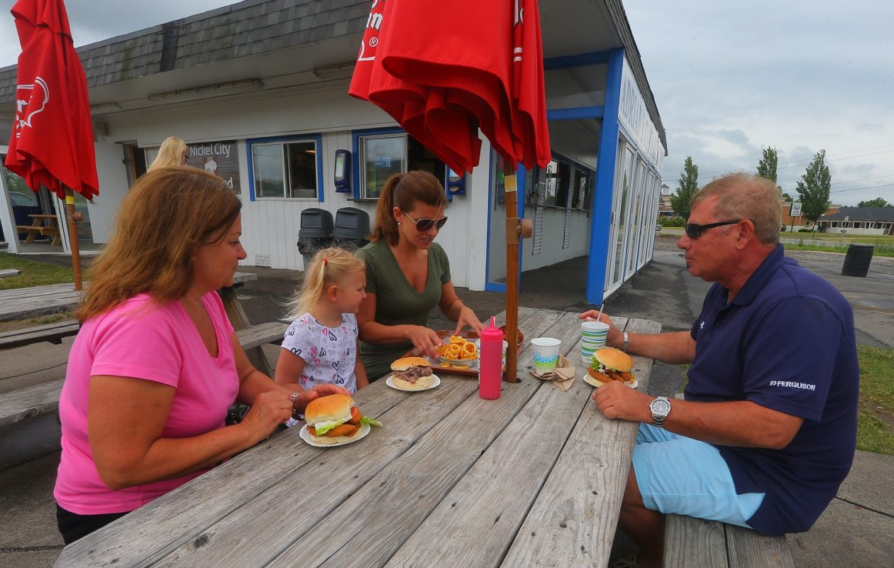 Joan Scibetta, left, Chloe Coats, 4, Danielle Coats, and Chuck Scibetta have lunch at Adrian's Custard, in Grand Island. (John Hickey/Buffalo News)