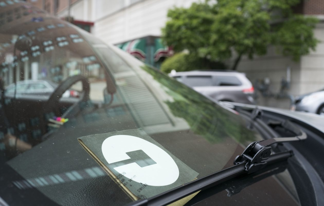 An Uber driver drops off a fare on Pearl Street in Buffalo. (Derek Gee/News file photo)