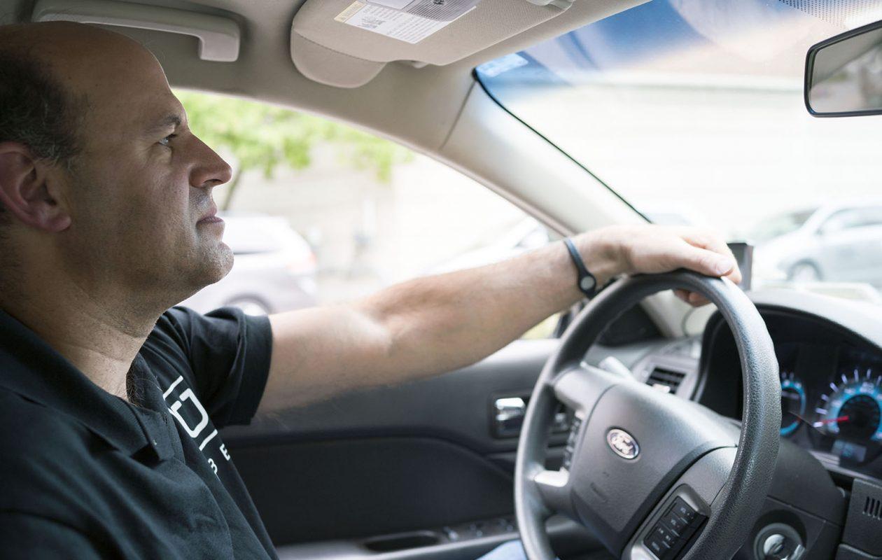 Uber Driver Simon Lissner drops off his second-ever fare on Pearl Street outside the Hyatt Regency in Buffalo on June 29. (Derek Gee/Buffalo News)