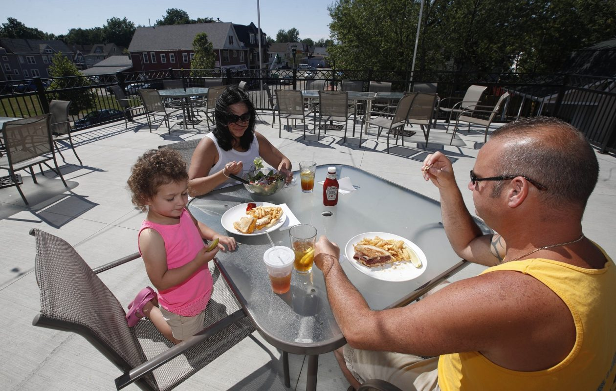 The Blackthorn Restaurant & Pub at 2134 Seneca St. has a new upstairs and downstairs patio. Nick and Denise Nardolillo, of Orchard Park, have a meal on the upstairs patio with their daughter Gianna, 2.  (Sharon Cantillon/Buffalo News)