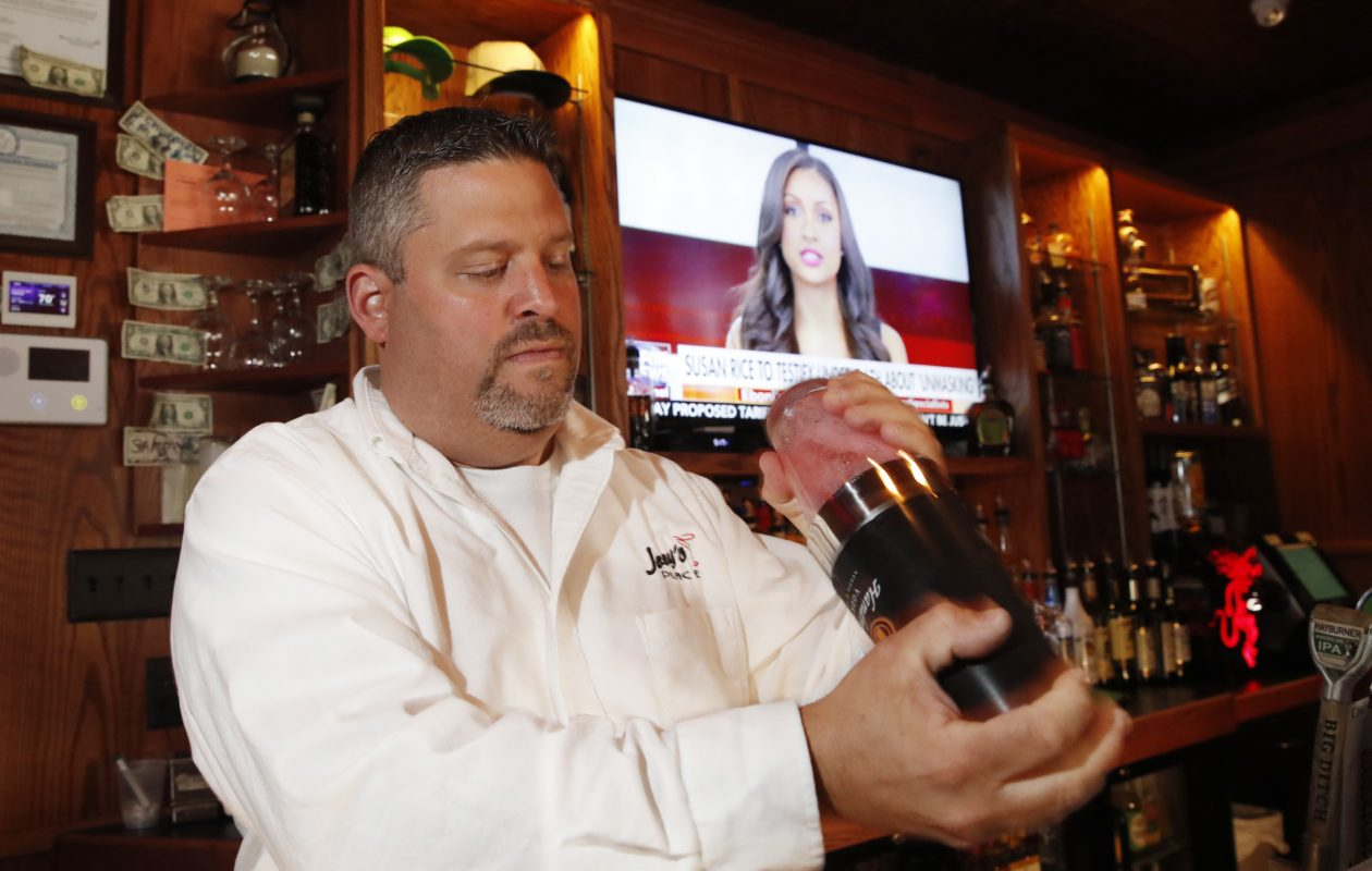 Joey's Place opened in January at 1122 Hertel Ave.   Owner and bartender Joe Dallos Jr. makes a cosmo.  (Sharon Cantillon/Buffalo News)