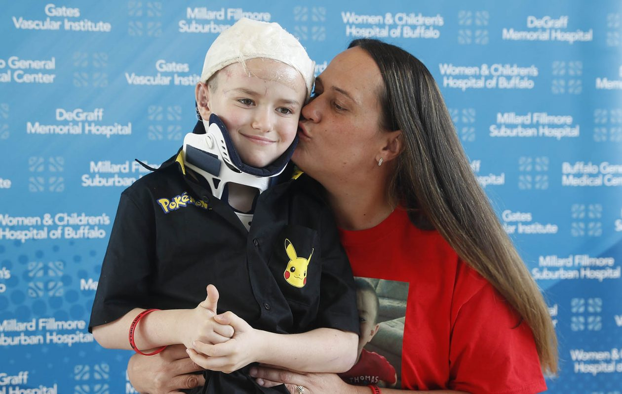 Vikki Avino and her son, dog bite victim Kaeden Mitchell, at Gates Vascular Institute, in Buffalo, N.Y. Kaeden was hospitalized for about a month after he was attacked in Niagara Falls by his babysitter's Rottweiler. (John Hickey/Buffalo News)