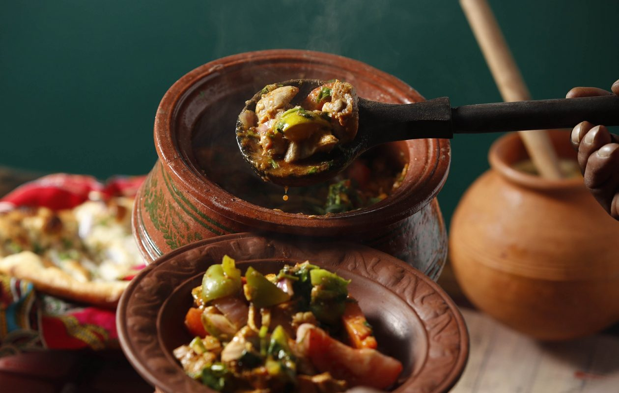 Chicken Jalfrezi is made with boneless chicken, yogurt, herbs and spices, bell peppers, onion, tomatoes then cooked and served in the clay pot. (Sharon Cantillon/Buffalo News)