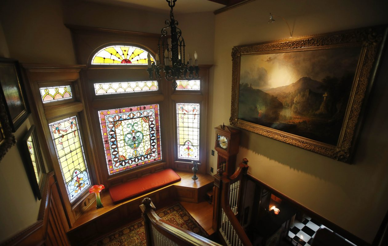 The stained-glass windows on the landing of this restored home are original.  (Sharon Cantillon/Buffalo News)