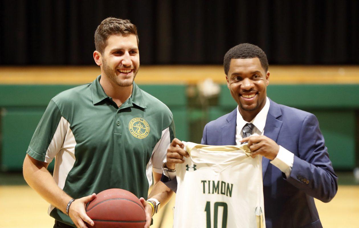 Timon AD Joe Licata introduces Jason Rowe, right, as the school's new basketball coach at the school in South Buffalo Wednesday. (Mark Mulville/Buffalo News)