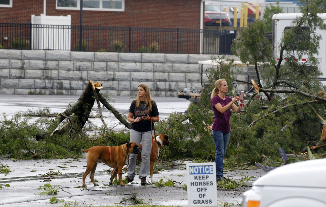 People look over the damage from the weather that came through the Fairgrounds in Hamburg Thursday, July 20, 2017            (Mark Mulville/Buffalo News)