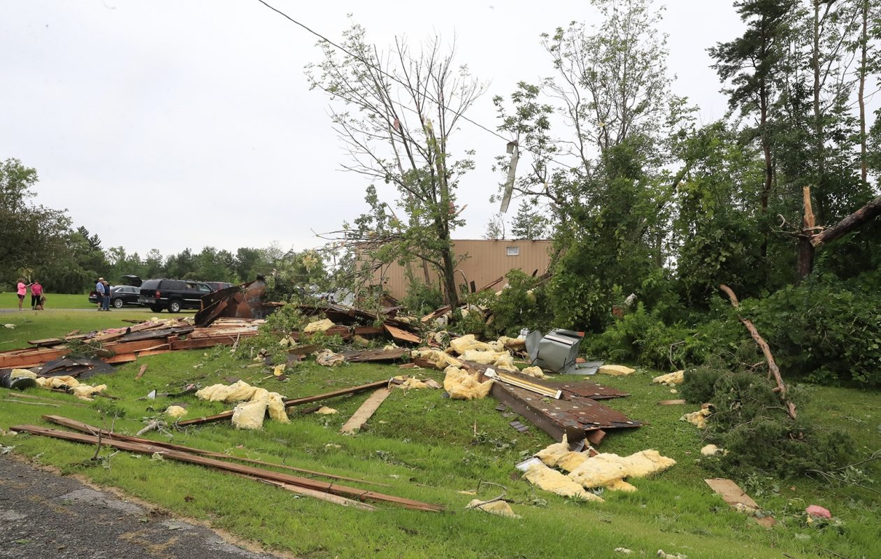 Tornado damage to a garage on the property of Roland Neuffer in Orchard Park. (Harry Scull Jr./Buffalo News)