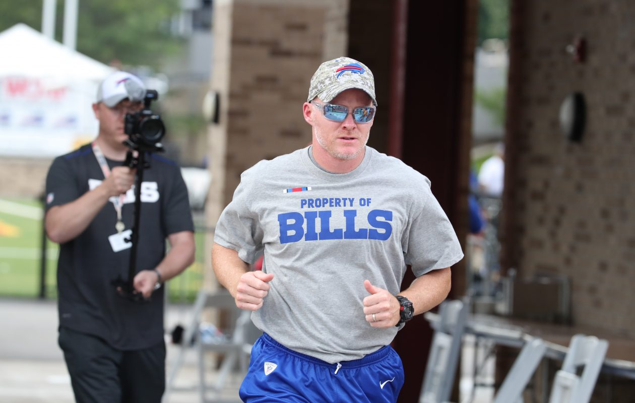 Buffalo Bills head coach Sean McDermott runs out to the field for the first day of the Bills training camp at St. John Fisher College. (James P. McCoy/Buffalo News)