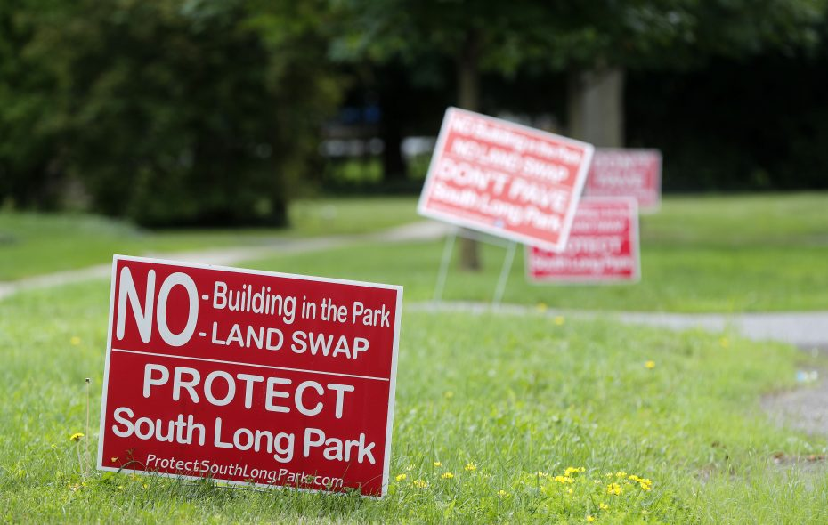 Residents on Garden Parkway put signs in front of their homes supporting saving South Long Park in Williamsville on Friday, July 28, 2017. (Mark Mulville/Buffalo News)