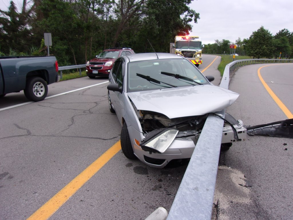 Guardrail sliced through the front of  a car on the Twin Cities Highway. (Tonawanda police  photo)